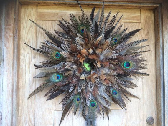 Pheasant feather wreath/wall decor with peacock feathers. Individually hand made. Looks stunning above a fireplace, on a door or as wall decor. 60 to 70cm diameter.