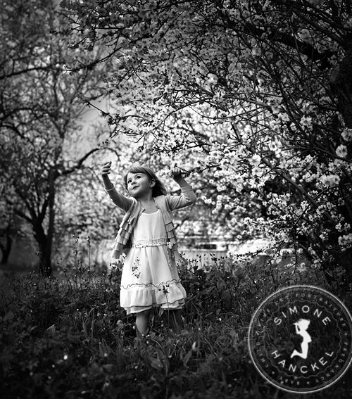 This little girl is one of my favourite muses. Her open, dancing heart is exactly why I photograph children, she gives me untold joy. This photograph is a love letter to her and her beautiful soul. © Simone Hanckel Photography