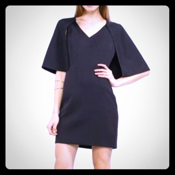 """🎄HP 12/6 🎄Black Mini Capelet Dress 100% Polyester. This sleeveless, v-neck dress features a bold cape that connects mid-armhole, then wraps all the way around the back for superior style. Runs small. Bust: 35"""" Waist 27"""" Hips: 36"""". Boutique Dresses Mini"""