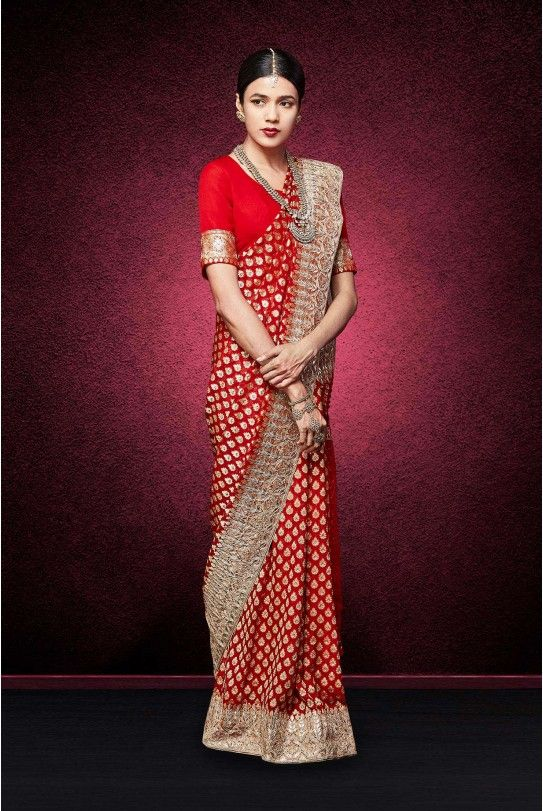 THE SANA #SAREE A red georgette handwoven saree with exquisite dori, gota patti, pearl and sequin embroidery, styled with a matching georgette choli with dori, resham, gota patti and sequin embroidery.