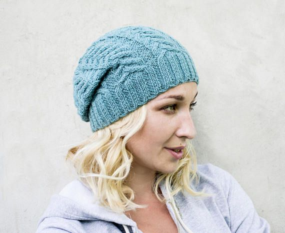 Knit slouchy beanie Cable knit hat Knitted hat for women Slouchy woolen hat Winter cap Cold weather beanie Womens winter hat Womens beanies Ready to ship!! Hand knitted spring hat, womens spring beanie teal color. This hat warm you when it is snowing, early spring or cold autumn. Also available from the author of the cable original pattern, which gives the exclusivity of these things. Good and original gift for your girl, women or mother that would show the love and care during the winter…