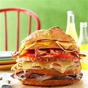 Big Sandwich Recipe -One look at this impressive sandwich and your family and friends will know their taste buds are in for a treat. I have served it many times for casual lunches and suppers. The tall layers prompt people to ask how they're supposed to eat it. I encourage them to simply dig in and enjoy! —Margaret Yost, Tipp City, Ohio