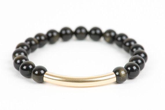 Golden Obsidian Bar bracelet. As an accent bead I added a Gold Filled bar that just brings more of the golden sheen that's in the #Obsidian beads.  Obsidian it's a Root chakra stone. It's a grounding stone; it will create a protective shield that will help to remain centered when faced with negative energy. Obsidian helps to dissolve pain, tension, and blockages. #handmadejewelry #gifts #gemstone #gemstonejewelry #gemstones #jewelry