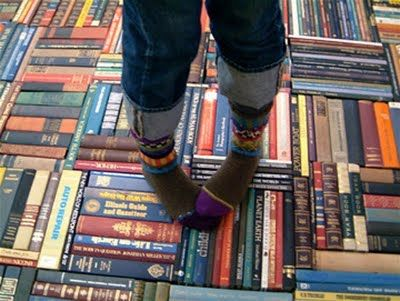 Ingenious repurposing old books into a carpet. Kind of cool!