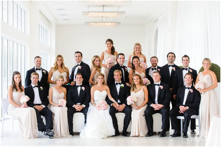 LOVE this set up - mixed wedding party standing and sitting