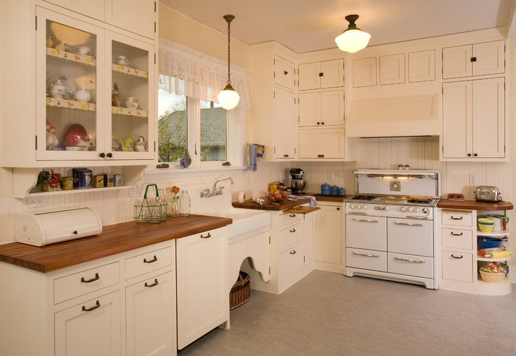 1920's Historic Kitchen - traditional - kitchen - seattle - Sadro Design Studio Inc.  School boy lights, wood counter top, cabinets
