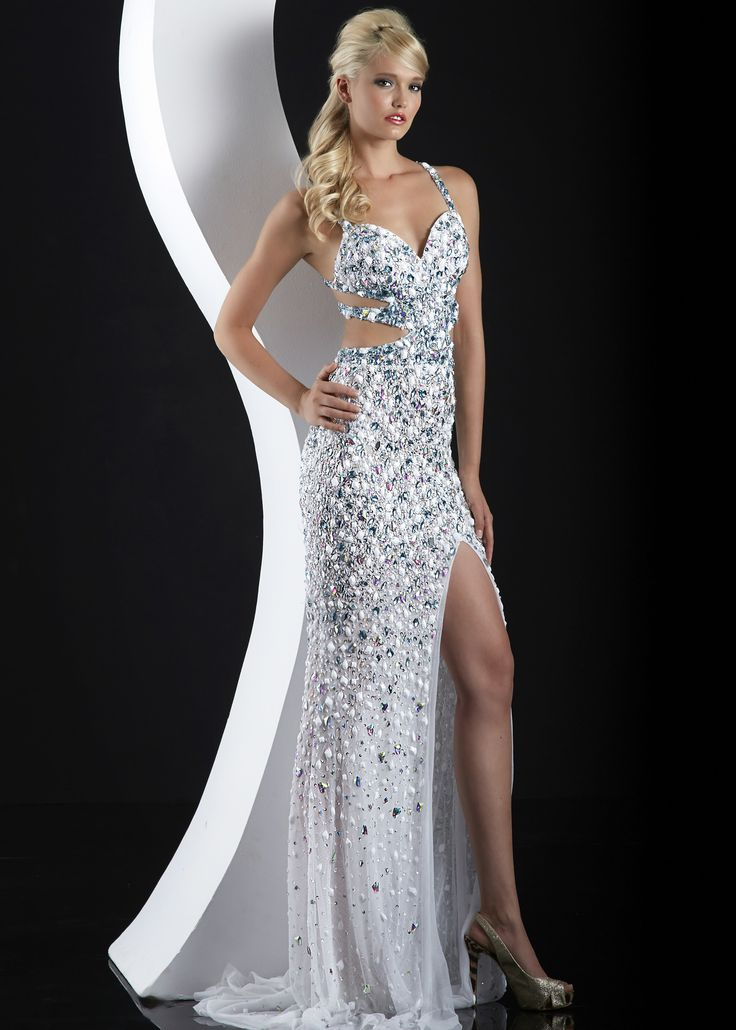 Sparkle in this beaded cut out illusion dress. what a beauty!