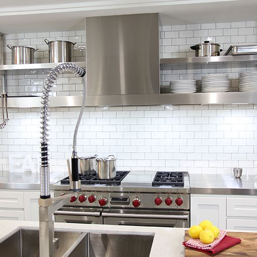 Open shelving, stainless steel appliances and white tiles create a modern, industrial look in this Winning Kitchen in Castle Hill. Designed by Kastell Kitchens the appliances include: Abey Tap Fisher & Paykel Dishwasher Oliveri Sink Sub-Zero Fridge Wolf Oven