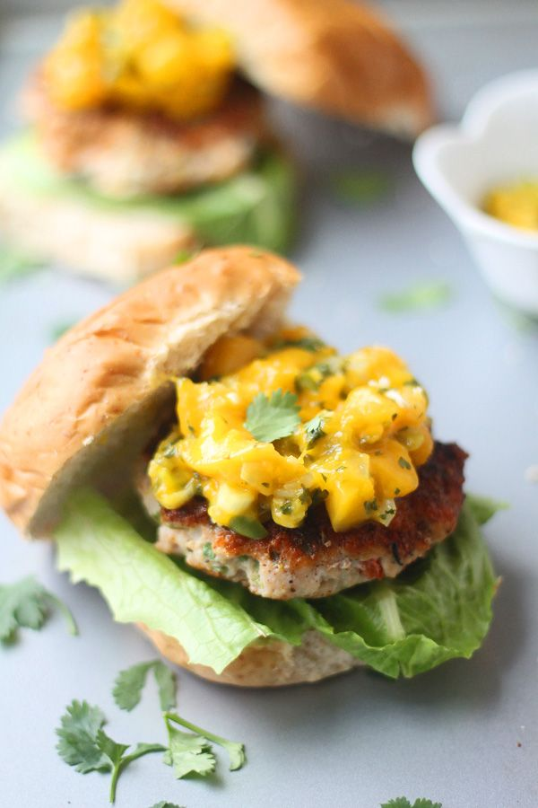 Blackened Chicken Burgers with Warm Mango Salsa |  Yum! And the vitamin C in the mango boosts the absorption of the iron in the chicken!