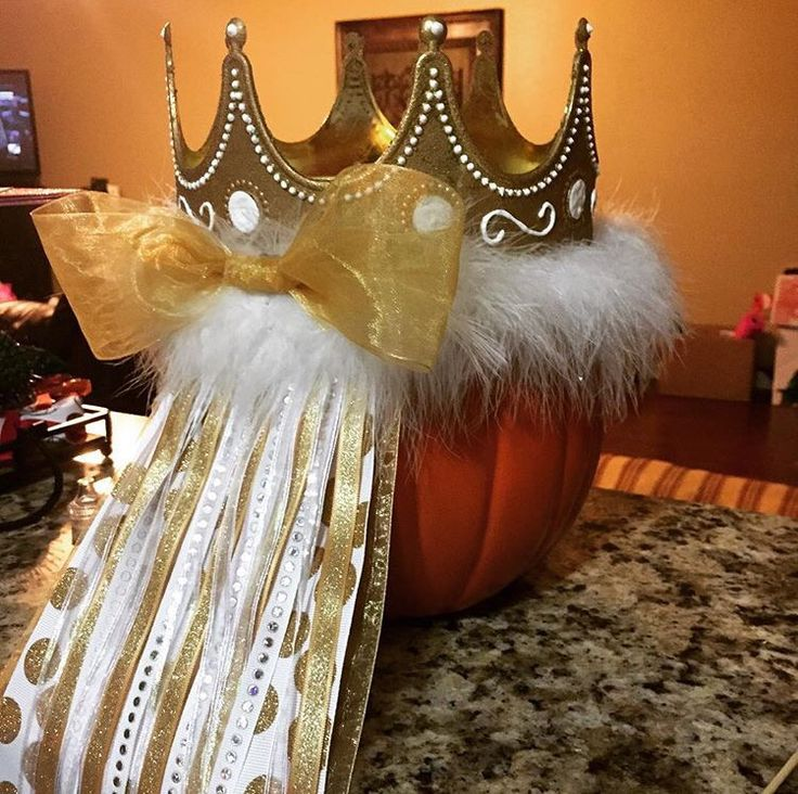 Gold and white senior crown                                                                                                                                                     More