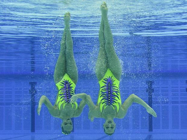 April 18, 2012: Giulia Lapi and Mariangela Perrupato of Italy perform in the Duets Technical Routine during a synchronised swimming qualification event at the Aquatic Centre at Olympic Park in Stratford in east London. I actually love synchronized swimming. www.london2012.com #olympics #london2012 #swimming