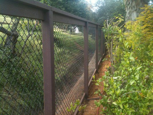 Wooden frame for chain link fence. Love this idea for not replacing but making nicer.