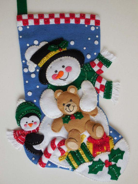 Final media de la Navidad - muñeco de nieve y oso de peluche