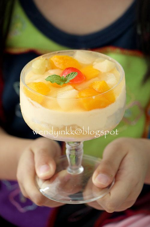 Creme de Fruta is a popular dessert in Philippines. It's sponge fingers (known as broas in Philippines) with custard, topped with canned ...