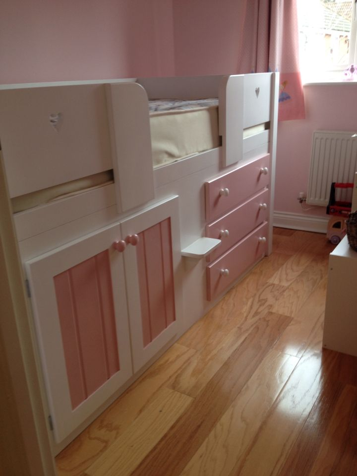 White and princess pink 3 drawer childrens cabin bed with heart cutouts.  This bed is
