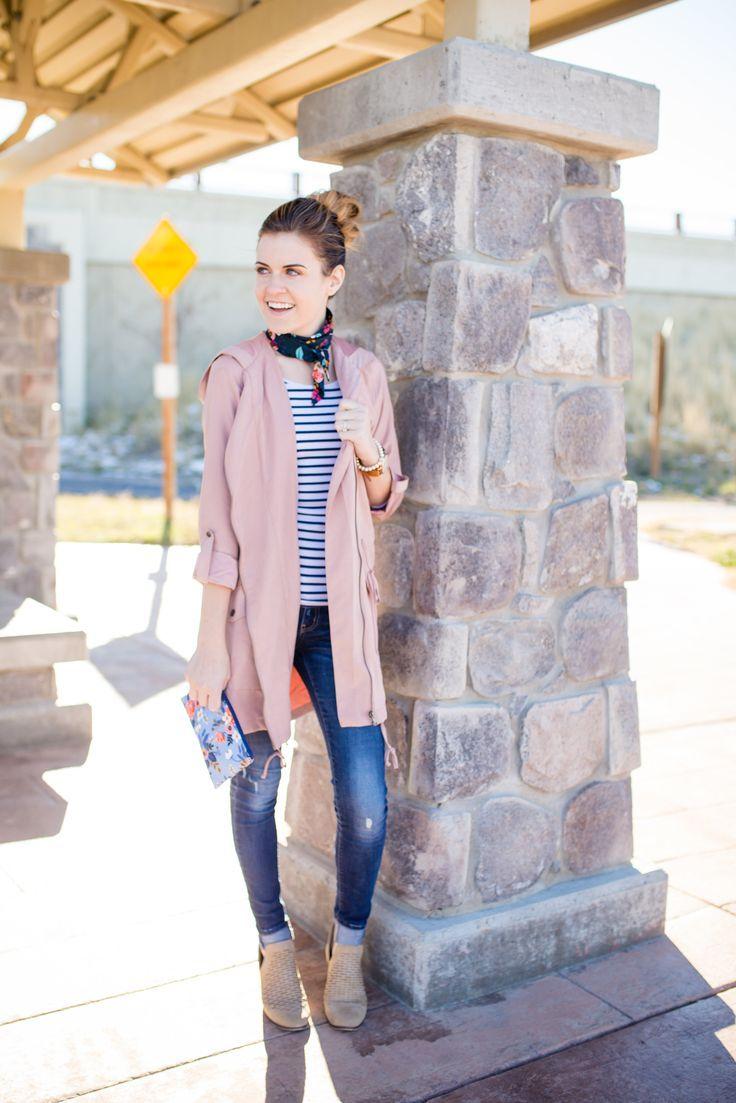 pink blush jacket, stripe shirt, floral necktie, light tan eyelit booties, alex and ani bracelet, ARVO watch, pearl bracelet, blue jeans, floral clutch, and high messy bun