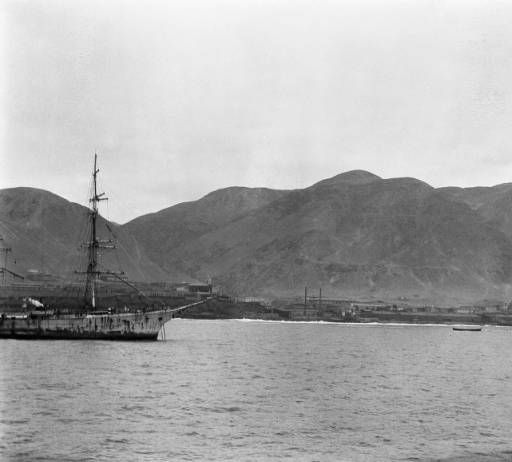 Coloso (Chile), boats in port bordering town :: AGSL Digital Photo Archive - South America