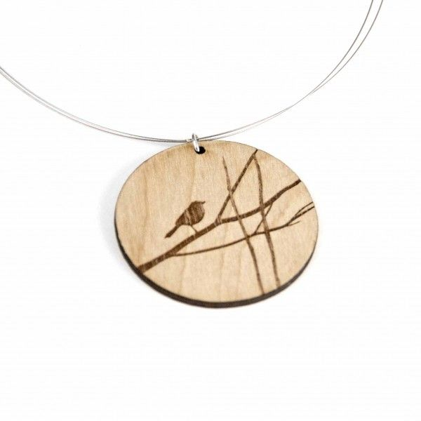 Brickbubble — Sweet silhouette bird on a branch wood circle pendant. Original design, simple silhouette bird engraved into birch veneer plywood. Something sweet for the nature lover in all of us. 2″ (5 cm) diameter circle, 17″ (43.2 cm) long wire necklace.