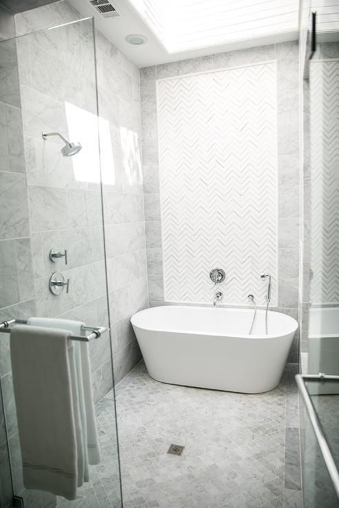 A Seamless Glass Shower Is Fitted With Gray Arabesque