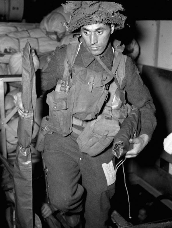 Private jack Roy, Régiment de la Chaudière, preparing to disembark from H.M.C.S. PRINCE DAVID off the Normandy beachhead on june 6, 1944. Photographer: Donovan J. Thorndick