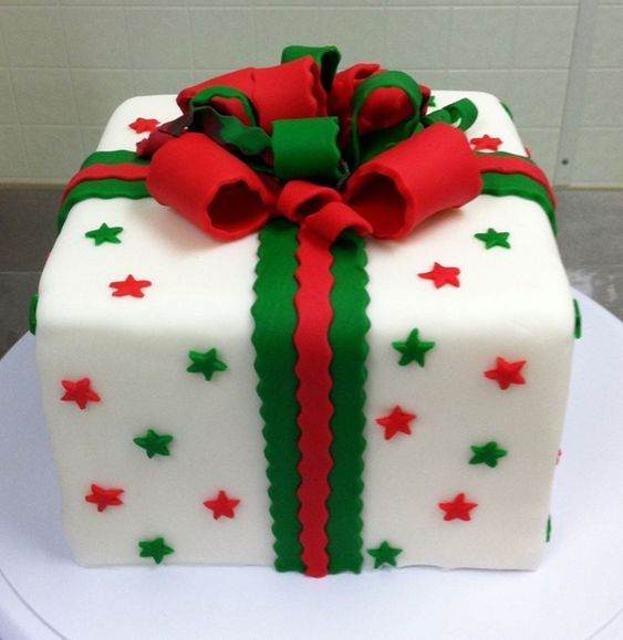 Gift themed Christmas cake. The cake is decorated to look like a Christmas gift …