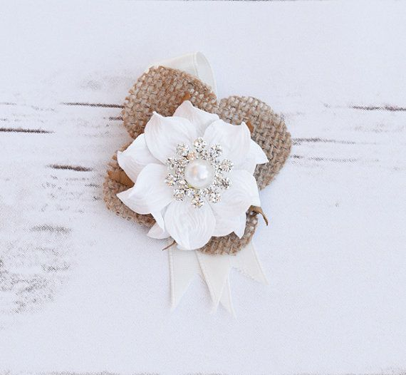 This is a cute and delicate Burlap Hydrangea Petal accented with Small Gardenia Flower and a Rhinestone or Pearl Brooch. Adorable and Delicate would be great as a Small Corsage or Boutonniere for Rustic Shabby Chic Wedding! Measures about 2 Wide. Something about us: Wedideas.com has been