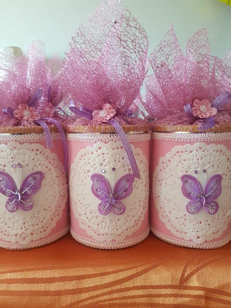 Latas de leche decoradas con mariposas