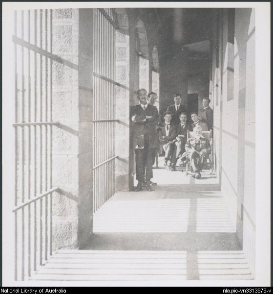 nla.pic-vn3313979 Albert Dryer, Kiely and the Irish internees in corridor at Darlinghurst Gaol, Sydney, 1918-1919 [picture]. [between 1918 and 1919] 1 photograph : b&w ; image 12.2 x 11 cm., on sheet 16.5 x 12.1 cm. Part of Dryer, Albert, 1888-1963. Albert Dryer photograph collection, 1914-1955 [picture] between 1914 and 1955