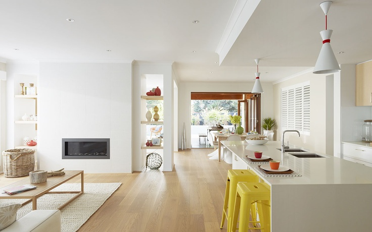 The use of white & pale wood have this open space feeling light & airy.