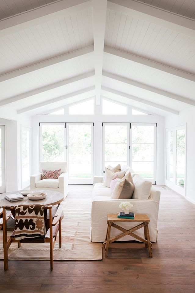 Large living room with lots of natural light, white walls, and wood floors | Winding Creek – Wendy Word