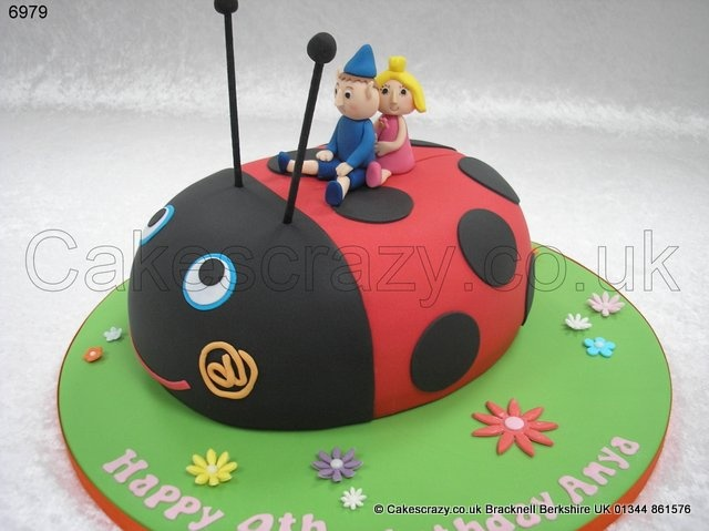 Ben and Holly Ladybird Cake. The enchanted little kingdom....  Gaston the ladybird shaped childrens cake with his best friends Ben and Holly riding on his back all made from icing.  The perfect cake for young followers of the TV show