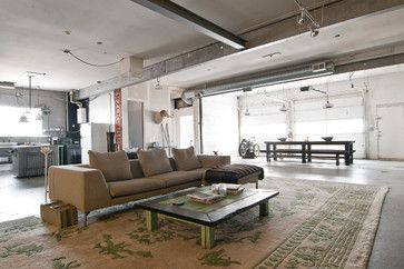 Spencer Steed, Alex Tovey and their French bulldog, Simon, turned a former auto garage into a cozy-yet-industrial home fit for a young couple. I love industrial spaces.