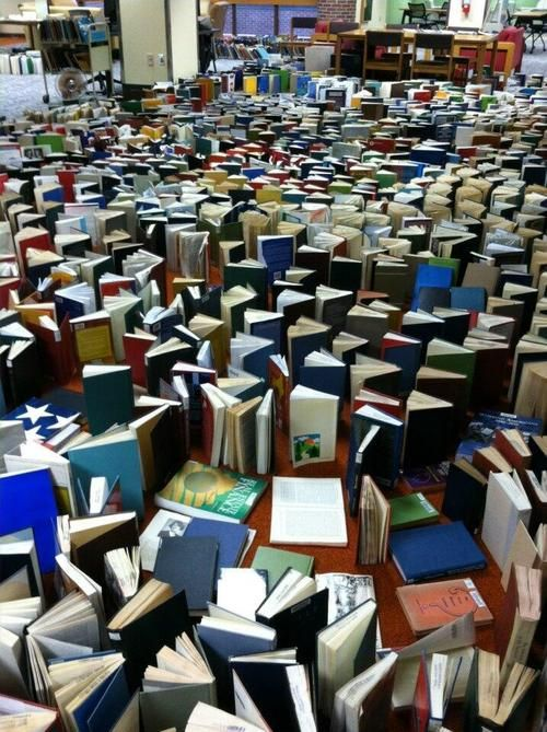 Books set out to dry at the University of Nebraska Kearney Library after a massive storm ripped the roof off the building.