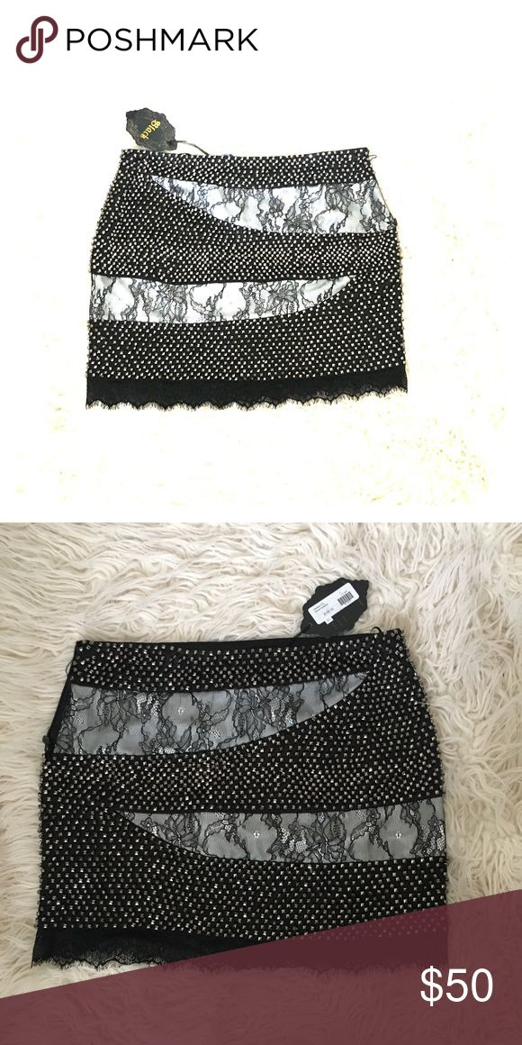 Studded mini skirt Black& white studded skirt with lace detail. Brand new with tags. Broken zipper Black Skirts Mini