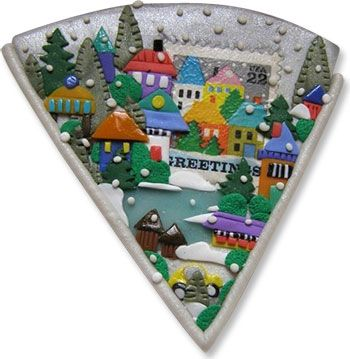 Greetings brooch (the village is centered around a postage stamp.)
