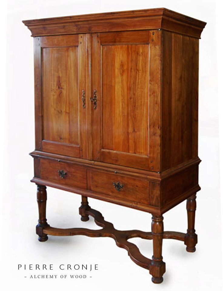A Pierre Cronje Cape Armoire with Cross Stretcher.