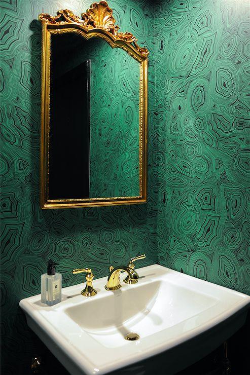 Emerald Green Powder Room with Gold Ornate Mirror Cole & Son Malachite Fornasetti wallpaper gold mirror