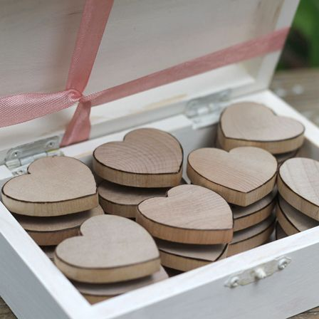 Share the Love - fabulous wedding favours.  Wooden hearts can be engraved on or tie a ribbon on for a piece of home décor