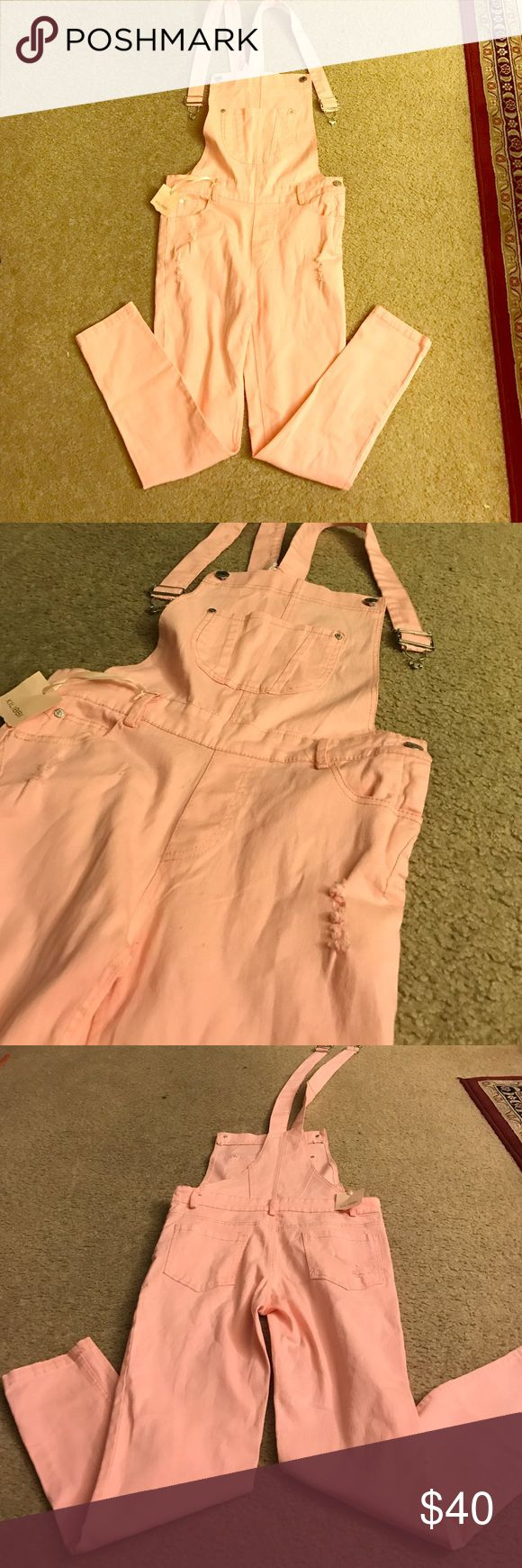 Cute Pink jean overalls 💞 Super adorable baby pink jean overalls. Bey comfortable. Never worn. Good fit Kilibbi Jeans Overalls