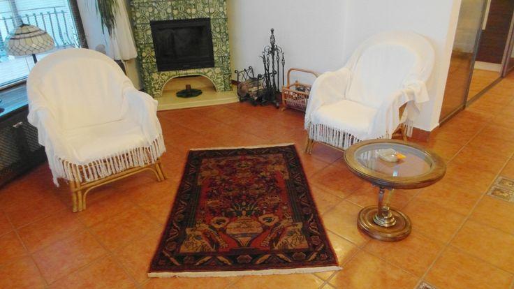 A Semi-Antique Jozan - Sarouk carpet in a house in Romania
