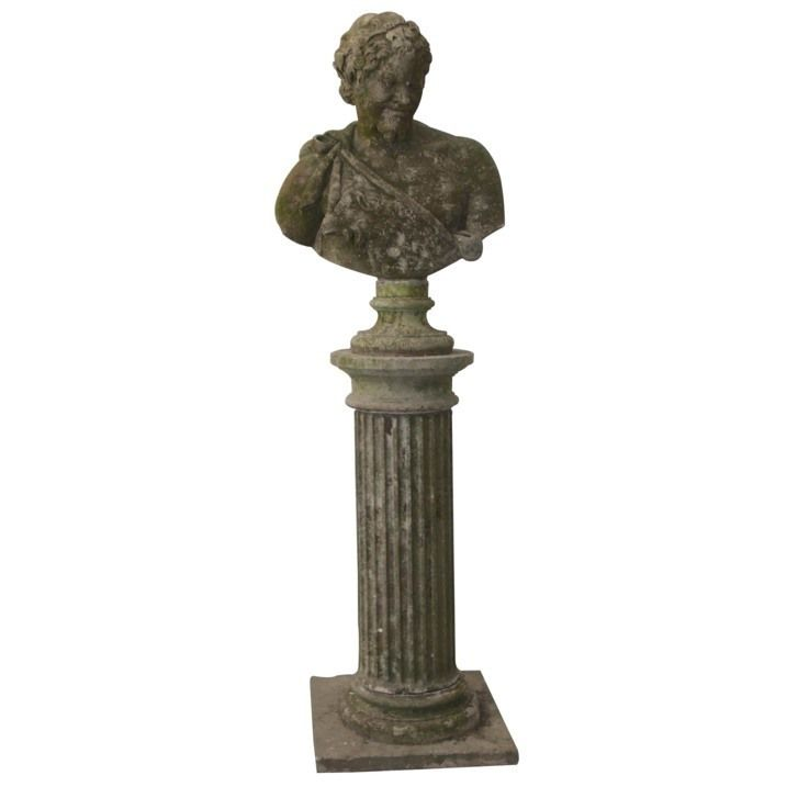 A well weathered cast stone Bacchus. http://www.lorfordsantiques.com/product/cast-stone-bust-of-bacchus