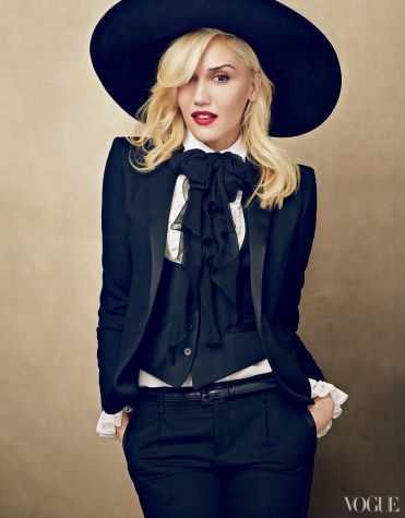 I am kind of wearing this outfit today.  Except without a hat and my bow is red, not black.  Gwen Stefani: Leader of the Pack Editorial - Vogue