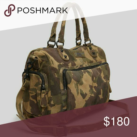 "Liebeskind Camo Laptop Satchel Crossbody Bag Exposed zip pockets and slouchy construction lend a masculine feel to this camouflage nubuck Liebeskind satchel. Matte black hardware and studs. A magnetic-flap pocket and on-seam compartment detail the back. Double handles and optional, adjustable shoulder strap. Metallic interior with 3 pockets. Leather.  12x17x4 with 5"" handle drop. Pre-owned with some light wear on outside. Some fading of metallic on inner fabric from items coming and going…"
