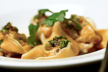 Fresh, silky prawn wontons with a Sichuan-inspired sauce. Kylie Kwong
