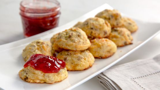 These are so easy to make and taste like a sausage and cheese biscuit all rolled into one! This comes from the Jiffy mix recipe book.