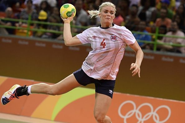 Norway's left back Veronica Kristiansen jumps to shoot during the women's semifinal handball match Norway vs Russia for the Rio 2016 Olympics Games...  (594×396)