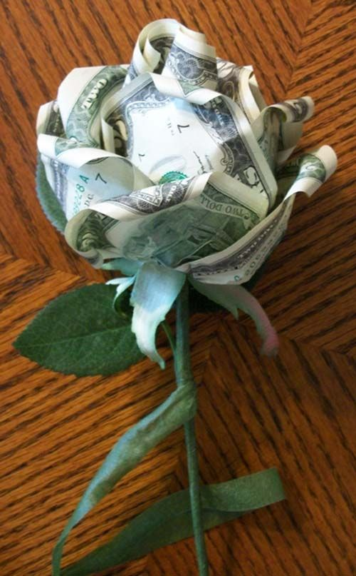dollars into a rose flower... pretty as a monetary gift