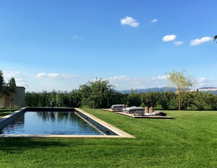 A spacious swimming pool with lounge terrace at Villa Spello Umbria