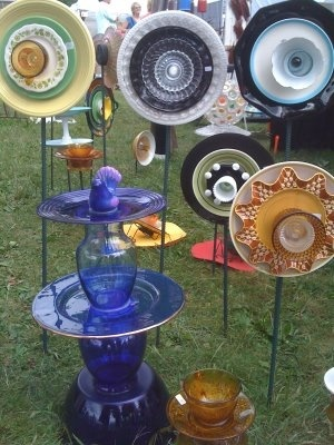 Glass vases in 2nd hand stores are abundant ... platters, trays ... easy plant stands, or art displays, inside .... hmmmm ... where can this go with a little finesse?