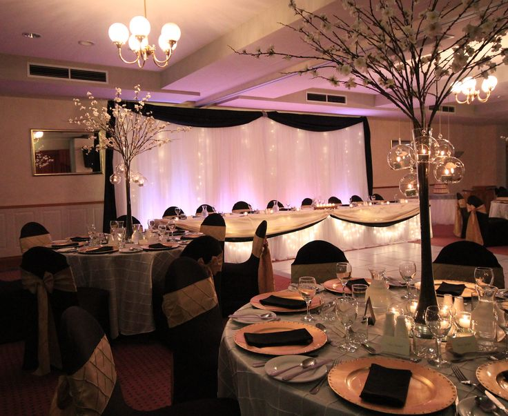 Tamar valley resort wedding reception with backdrop and cherry blossom centrepieces